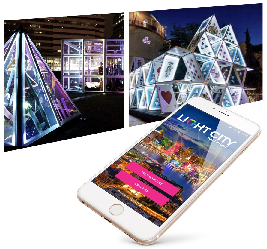 Art installations with Light City Baltimore app displayed on smartphone.