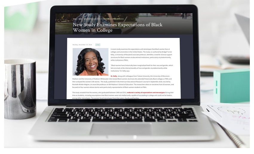 "Article feature titled ""New Study Expectations of Black Women in College"" displayed on a laptop."