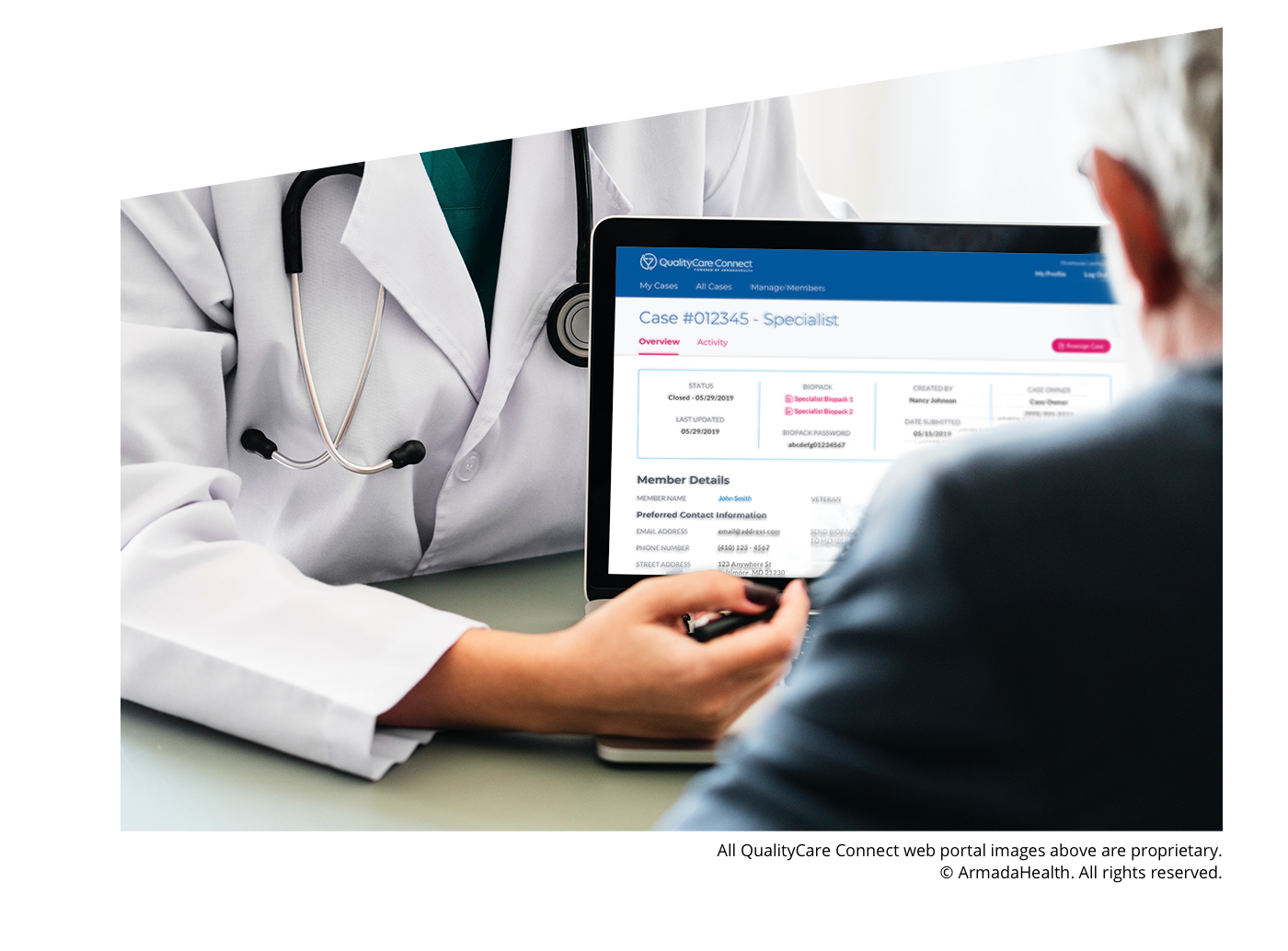 A doctor showing a patient some information using ArmadaHealth's web portal