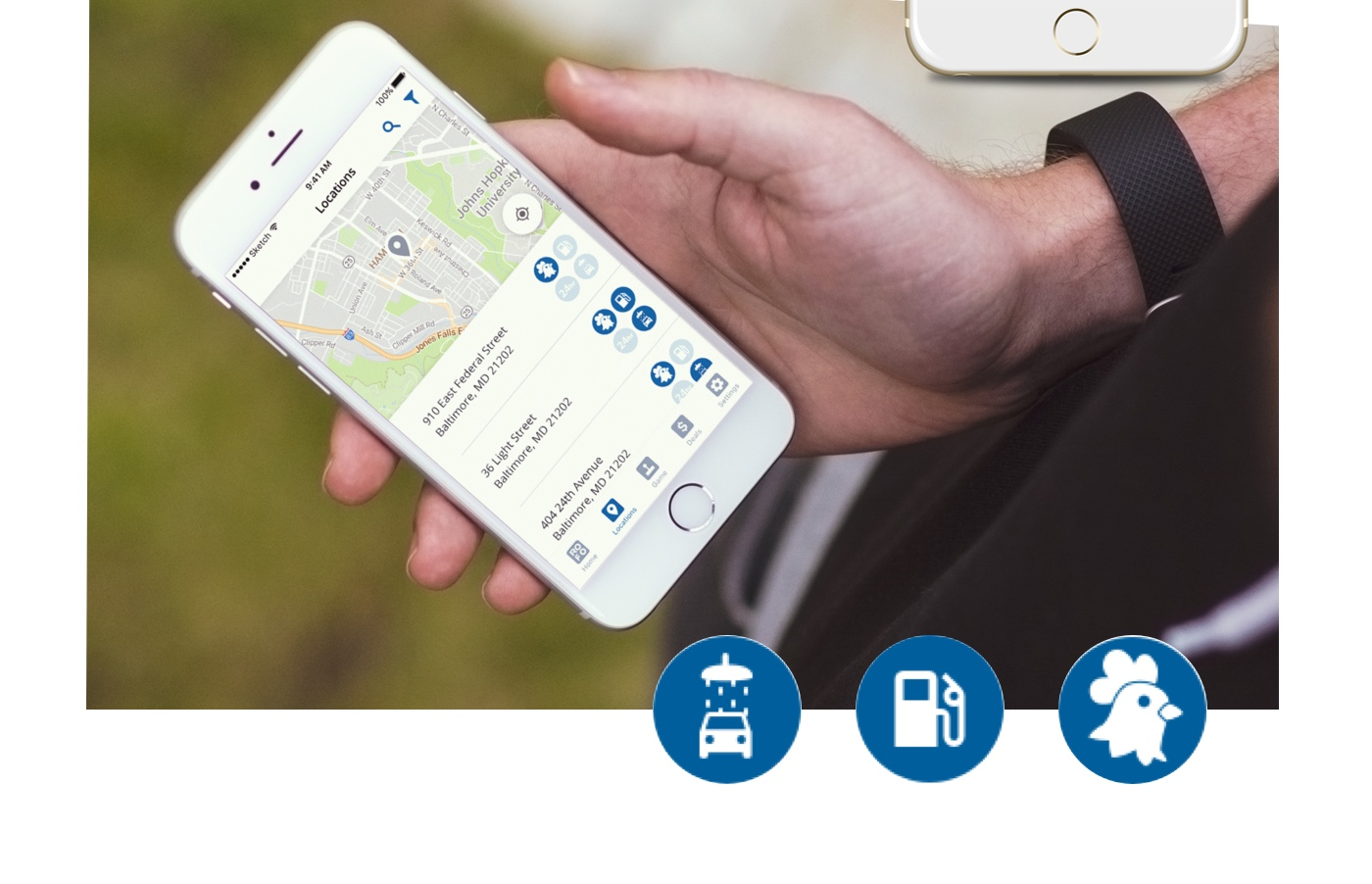 A person's hand holding an iphone with the Royal Farms app showing nearby locations