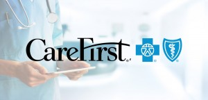 CareFirst logo in the foreground. A healthcare worker holding a mobile device in the background.