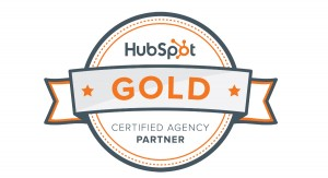 "A gray and orange bordered certification badge that reads ""HubSpot Gold Certified Agency Partner"""
