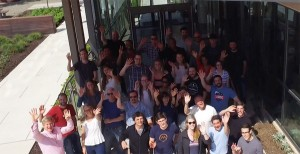 Mindgrub employees waving to the camera outside the office building.