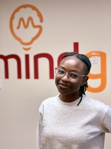 Sandra Koranteng in front of Mindgrub vinyl sign